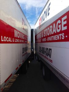 close up of the space between two moving trucks