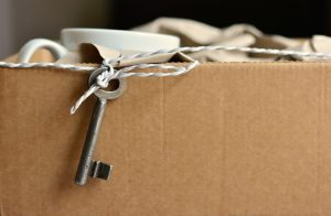 a key tied on a string hanging on the side of a box