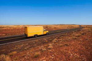 Yellow truck making a long distance move in Tucson Arizona desert